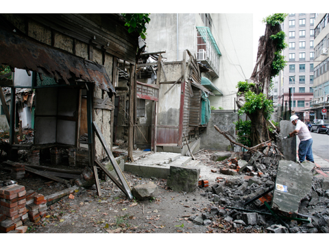 Removing the wall of a Ruined house,Qidong Street. Taipei 2008